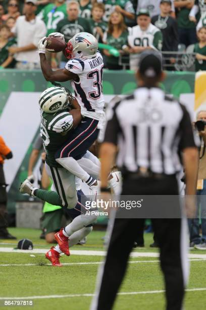 Defensive Back Duron Harmon of the New England Patriots breaks up a pass in action against the New York Jets during their game at MetLife Stadium on...