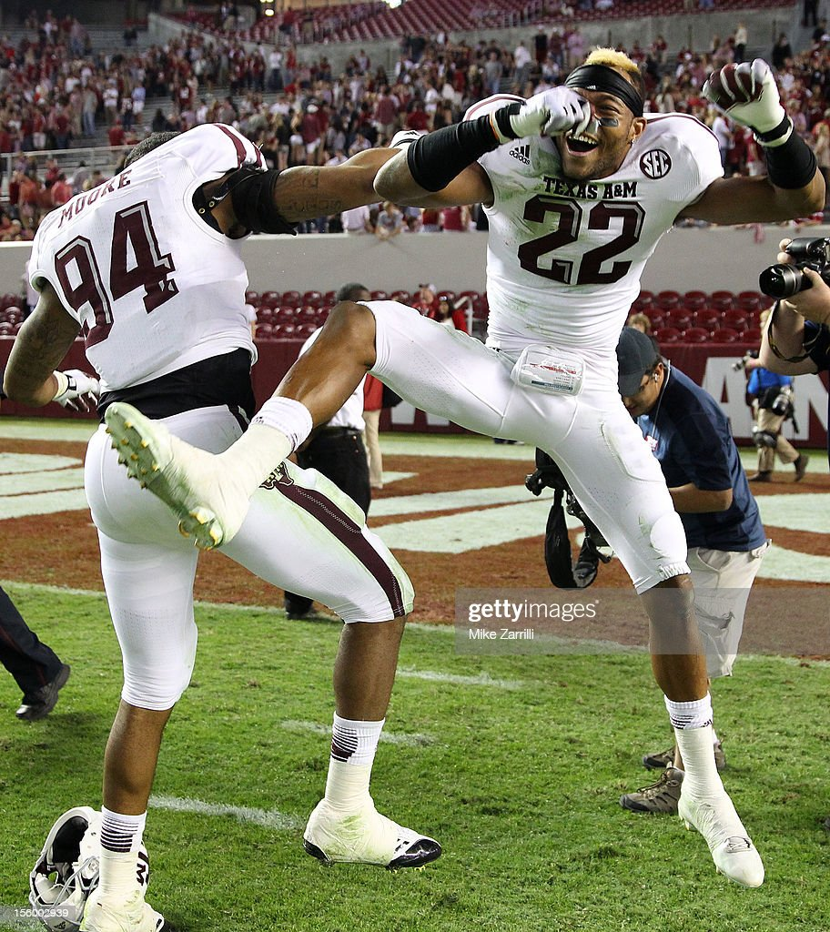 Defensive back Dustin Harris #22 of the Texas A&M Aggies (right) celebrates with defensive lineman and teammate Demontre Moore #94 after the game against the Texas A&M Aggies at Bryant-Denny Stadium on November 10, 2012 in Tuscaloosa, Alabama.