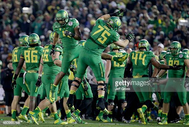 Defensive back Erick Dargan and offensive lineman Jake Fisher of the Oregon Ducks celebrate an interception against the Florida State Seminoles...