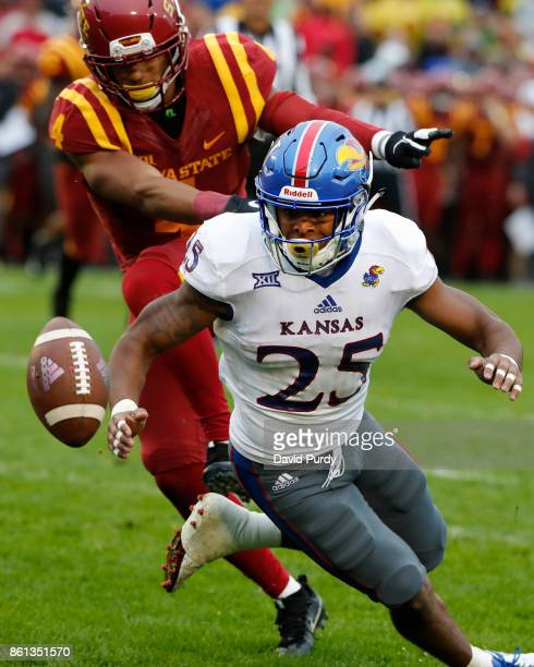 Defensive back Evrett Edwards of the Iowa State Cyclones breaks up a pass meant for running back Dom Williams of the Kansas Jayhawks in the second...