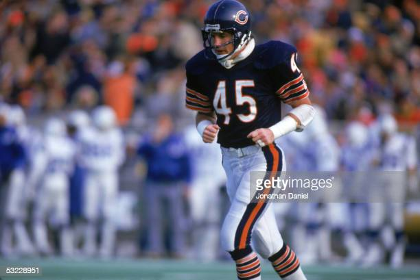 Defensive back Gary Fencik of the Chicago Bears runs on the field during the game against the Indianapolis Colts at Soldier Field on December 8 1985...