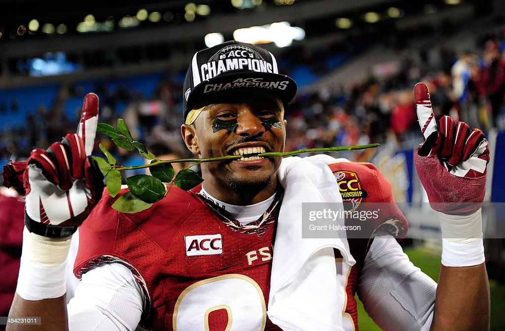 Defensive back Gerald Demps #23 of the Florida State Seminoles celebrates on the field after defeating the Duke Blue Devils 45-7 in the ACC Championship game at Bank of America Stadium on December 7, 2013 in Charlotte, North Carolina.