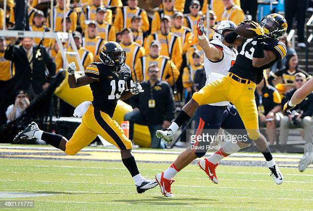Defensive back Greg Mabin of the Iowa Hawkeyes intercepts a pass intended for Tight end Tyler White of the Illinois Fighting Illini as defensive back...