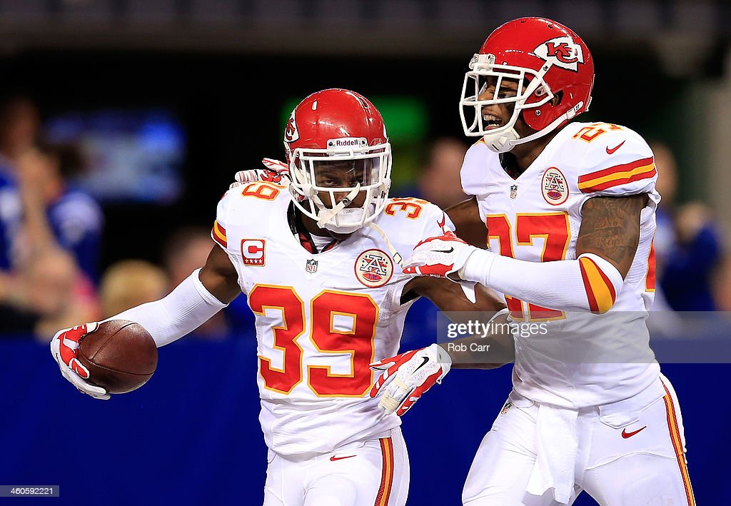 Defensive back <a gi-track='captionPersonalityLinkClicked' href=/galleries/search?phrase=Husain+Abdullah&family=editorial&specificpeople=2190074 ng-click='$event.stopPropagation()'>Husain Abdullah</a> #39 celebrates an interception with cornerback Sean Smith #27 of the Kansas City Chiefs against the Indianapolis Colts during a Wild Card Playoff game at Lucas Oil Stadium on January 4, 2014 in Indianapolis, Indiana.