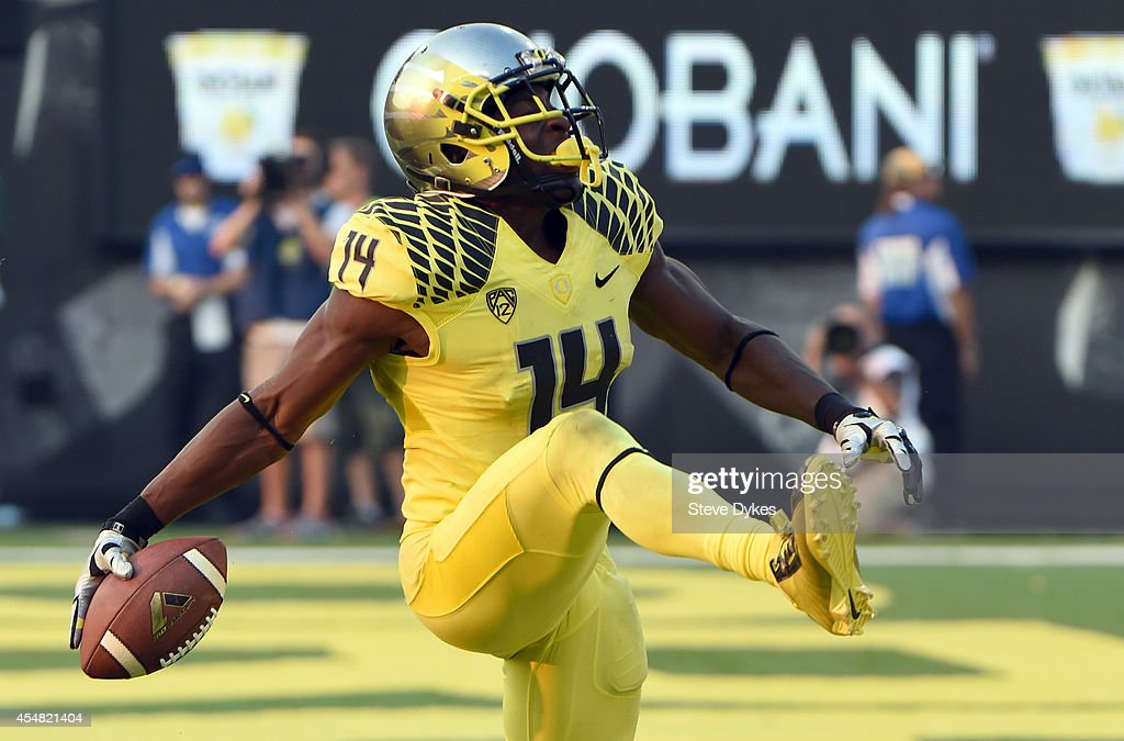 Defensive back Ifo EkpreOlomu of the Oregon Ducks celebrates after intercepting a pass during the fourth quarter of the game against the Michigan...
