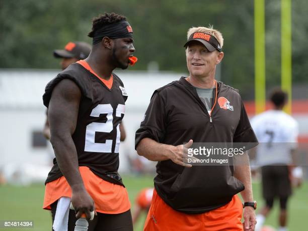 Defensive back Jabrill Peppers of the Cleveland Browns converses with special teams coordinator Chris Tabor as they walk off the field after a...
