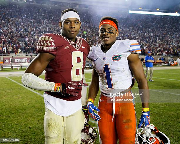 Defensive back Jalen Ramsey of the Florida State Seminoles posed with Defensive back Vernon Hargreaves III of the University of Florida Gators after...