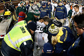 Defensive back Jalen WattsJackson of the Michigan State Spartans is lifted onto a stretcher after being injured on his game winning 38 yard touchdown...