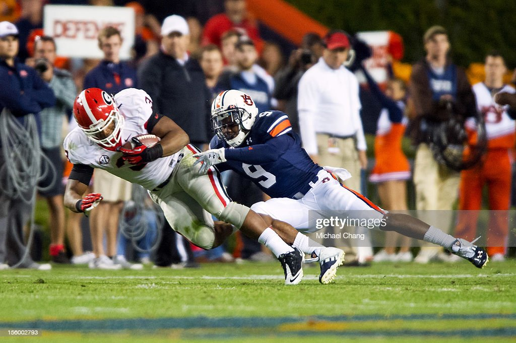 Defensive back Jermaine Whitehead #9 of the Auburn Tigers attempts to tackle running back <a gi-track='captionPersonalityLinkClicked' href=/galleries/search?phrase=Todd+Gurley&family=editorial&specificpeople=9688396 ng-click='$event.stopPropagation()'>Todd Gurley</a> #3 of the Georgia Bulldogs on November 10, 2012 at Jordan-Hare Stadium in Auburn, Alabama. Georgia leads Auburn 28-0 at halftime.