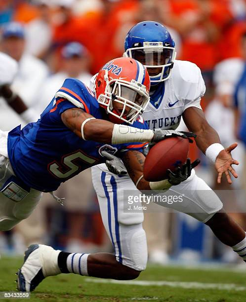 Defensive back Joe Haden of the Florida Gators steps in front of a Kentucky Wildcats receiver during the game at Ben Hill Griffin Stadium at Florida...