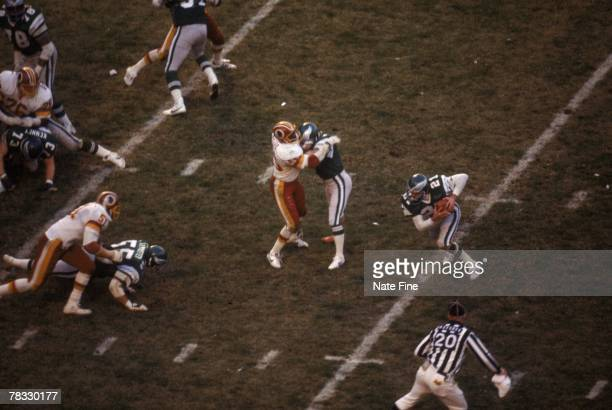 Defensive back John Sciarra of the Philadelphia Eagles returns an interception against the Washington Redskins on December 6 in Washington DC The...