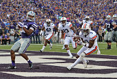 Defensive back Jonathan Jones of the Auburn Tigers intercepts a pass in the end zone that deflected off the helmet of wide receiver Tyler Lockett of...