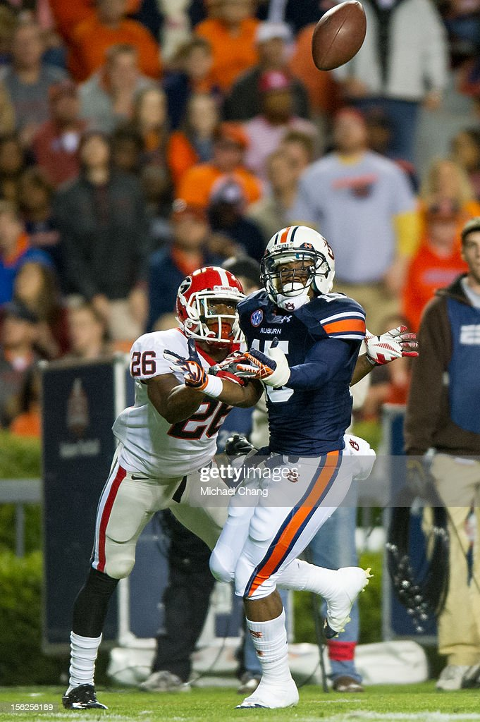 Defensive back Joshua Holsey #15 of the Auburn Tigers attempts to break up a pass intended for cornerback Malcolm Mitchell #26 of the Georgia Bulldogs on November 10, 2012 at Jordan-Hare Stadium in Auburn, Alabama. At halftime Georgia leads Auburn 28-0.