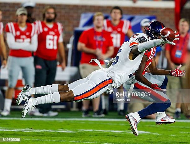 Defensive back Joshua Holsey of the Auburn Tigers breaks up a pass intended for tight end Evan Engram of the Mississippi Rebels during the first half...