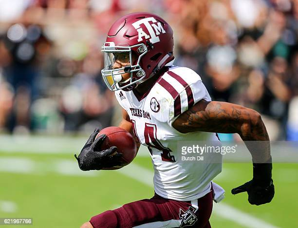 Defensive back Justin Evans of the Texas AM Aggies carries the ball on a punt return during the first half of an NCAA college football game against...