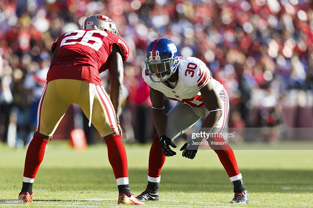 Defensive back Justin Tryon of the New York Giants lines up for a punt opposite of defensive back Tramaine Brock of the San Francisco 49ers during...