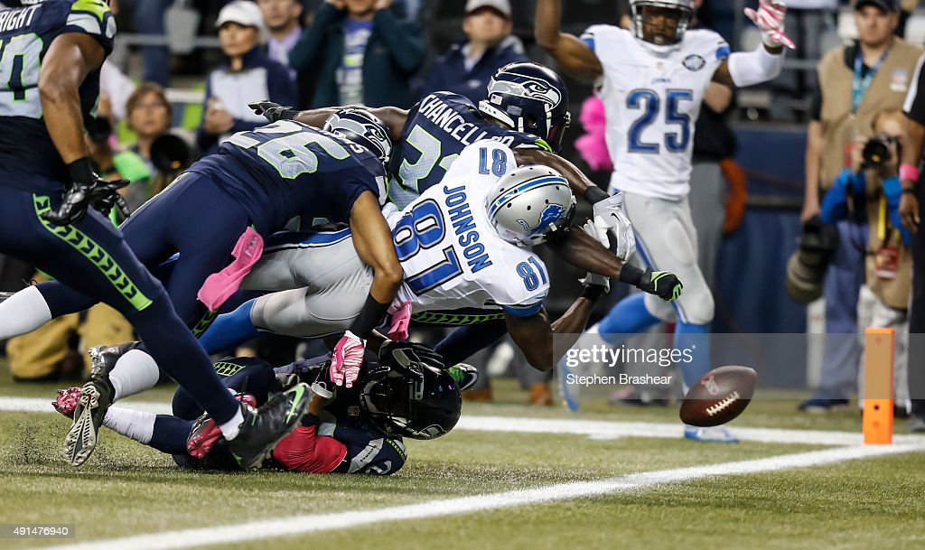 Defensive back <a gi-track='captionPersonalityLinkClicked' href=/galleries/search?phrase=Kam+Chancellor&family=editorial&specificpeople=4489525 ng-click='$event.stopPropagation()'>Kam Chancellor</a> #31 of the Seattle Seahawks knocks the ball out of the hands of wide receiver <a gi-track='captionPersonalityLinkClicked' href=/galleries/search?phrase=Calvin+Johnson+-+American+Football+Player&family=editorial&specificpeople=2253942 ng-click='$event.stopPropagation()'>Calvin Johnson</a> #81 of the Detroit Lions near the goal ling during the second half of a football game at CenturyLink Field on October 5, 2015 in Seattle, Washington. The Seahawks won the game 13-10.