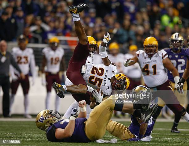 Defensive back Kareem Orr of the Arizona State Sun Devils is tackled after returning an interception against the Washington Huskies on November 19...