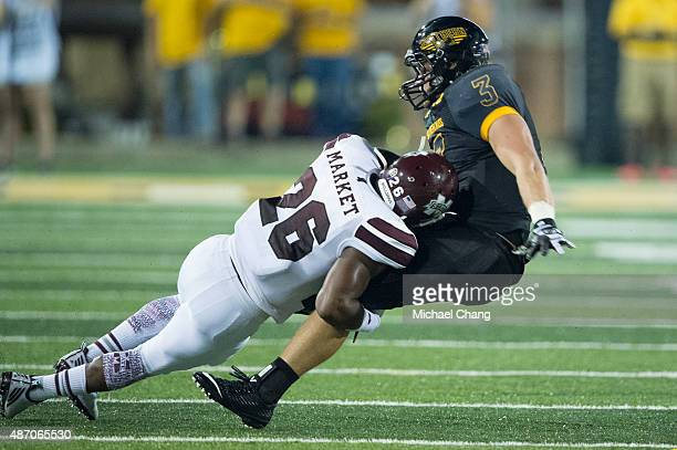 Defensive back Kendrick Market of the Mississippi State Bulldogs fullback Daythan Davis of the Southern Miss Golden Eagles on September 5 2015 at MM...