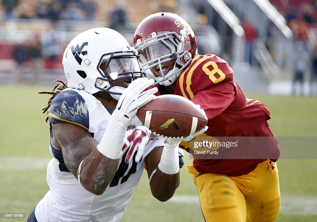 Defensive back Kenneth Lynn of the Iowa State Cyclones breaks up a pass meant for wide receiver Kevin White of the West Virginia Mountaineers in the...
