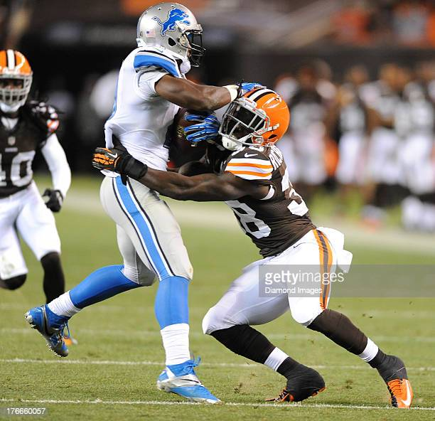 Defensive back Kent Richardson of the Cleveland Browns tackles running back Theo Riddick of the Detroit Lions during a game against the Detroit Lions...