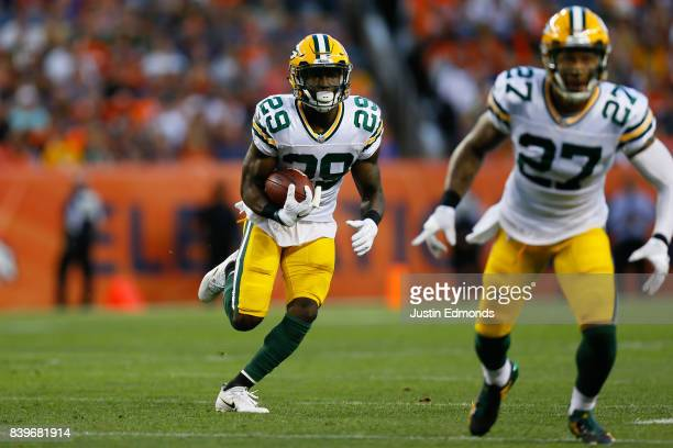 defensive back Kentrell Brice of the Green Bay Packers runs with the football after intercepting a pass as Josh Jones looks to block in the first...