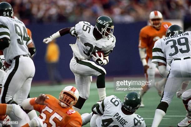 Defensive back Kerry Glenn of the New York Jets runs with the football against the Tampa Bay Buccaneers during a game at Giants Stadium on November...