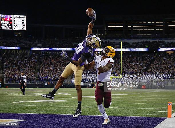 Defensive back Kevin King of the Washington Huskies makes an interception in the end zone against wide receiver N'Keal Harry of the Arizona State Sun...