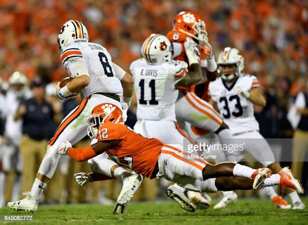 Defensive back K'Von Wallace of the Clemson Tigers tackles quarterback Jarrett Stidham of the Auburn Tigers during the football game at Memorial...