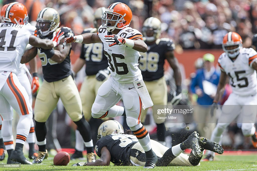 Defensive back K'Waun Williams #36 of the Cleveland Browns celebrates after tackling running back Travaris Cadet #39 of the New Orleans Saints at FirstEnergy Stadium on September 14, 2014 in Cleveland, Ohio.