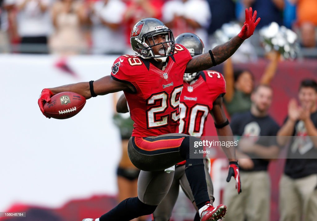 Defensive back Leonard Johnson #29 of the Tampa Bay Buccaneers celebrates his interception return for a touchdown against the San Diego Chargers during the game at Raymond James Stadium on November 11, 2012 in Tampa, Florida.