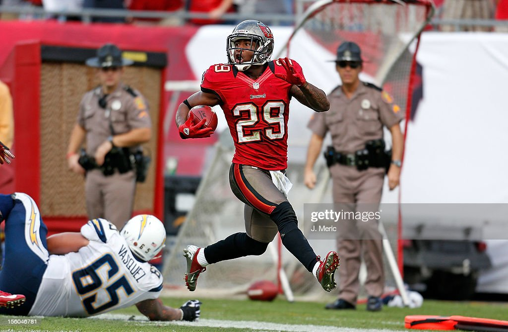 Defensive back Leonard Johnson #29 of the Tampa Bay Buccaneers runs back an interception for a touchdown against the San Diego Chargers during the game at Raymond James Stadium on November 11, 2012 in Tampa, Florida.