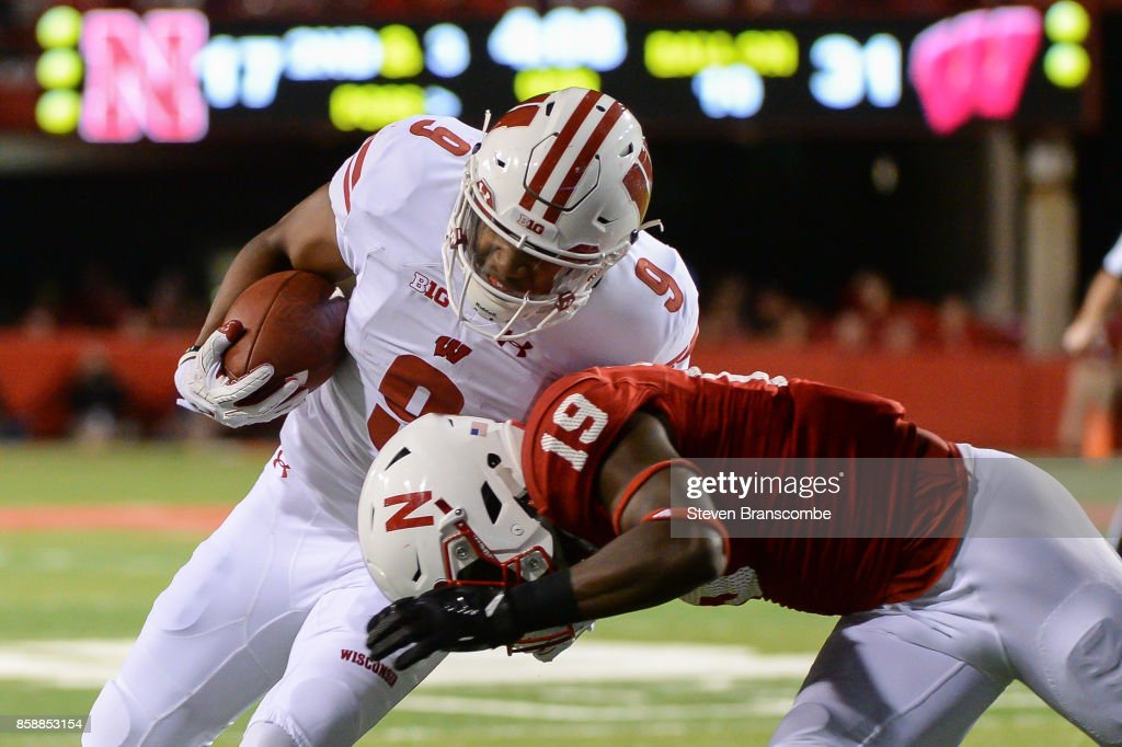 Defensive back Marquel Dismuke #19 of the Nebraska Cornhuskers tackles running back Rachid Ibrahim #9 of the Wisconsin Badgers at Memorial Stadium on October 7, 2017 in Lincoln, Nebraska.
