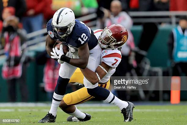 Defensive back Marvell Tell III of the USC Trojans attempts to tackle wide receiver Chris Godwin of the Penn State Nittany Lions in the first half of...