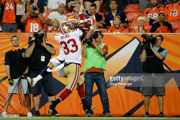 Defensive back Mylan Hicks of the San Francisco 49ers is called for pass interference against wide receiver Jordan Taylor of the Denver Broncos...