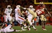Defensive back PJ Williams of the Florida State Seminoles fumbles the ball after intercepting a pass by quarterback Nick Marshall of the Auburn...