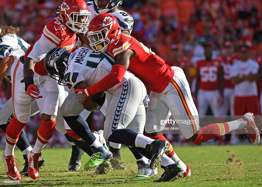Defensive back Randolph Shak #47 of the Kansas City Chiefs tackles running back Cameron Marshall #43 of the Seattle Seahawks during the second half on August 13, 2016 at Arrowhead Stadium in Kansas City, Missouri.