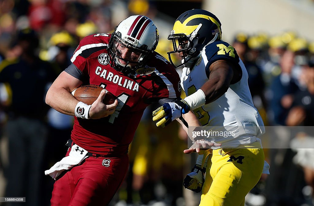 Defensive back Raymon Taylor #6 of the Michigan Wolverines runs down quarterback Connor Shaw #14 of the South Carolina Gamecocks during the Outback Bowl Game at Raymond James Stadium on January 1, 2013 in Tampa, Florida.