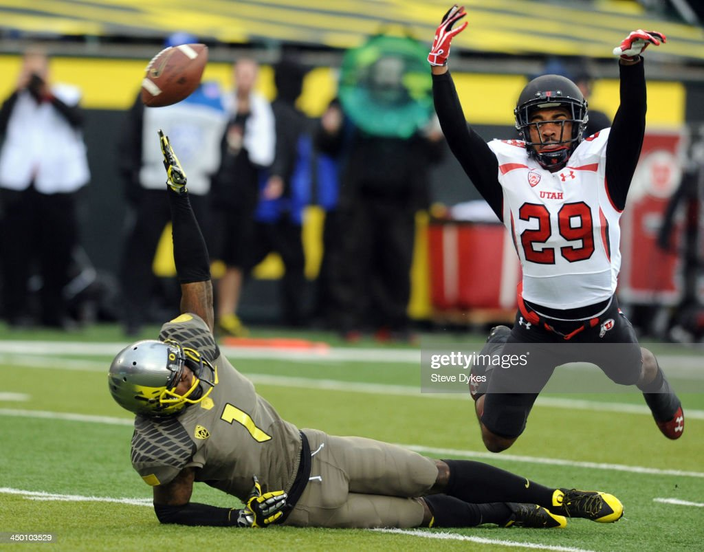 Defensive back Reginald Porter #29 of the Utah Utes is called for interference as he trips up wide receiver Josh Huff #1 of the Oregon Ducks during the third quarter of the game at Autzen Stadium on November 16, 2013 in Eugene, Oregon.