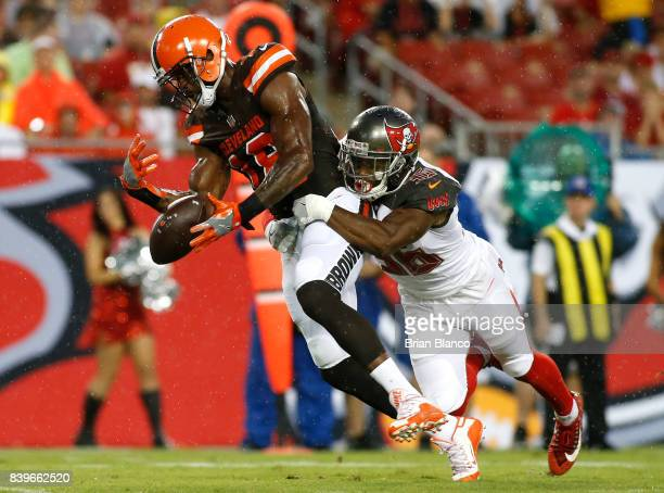 Defensive back Robert McClain of the Tampa Bay Buccaneers breaks up a pass intended for wide receiver Kenny Britt of the Cleveland Browns during the...