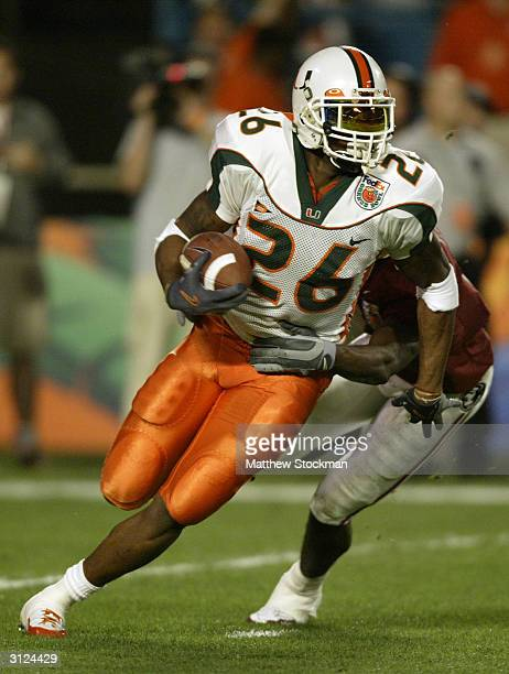 Defensive back Sean Taylor of the Miami Hurricanes attempts to elude wide receiver PK Sam of the Florida State Seminoles during the 2004 Orange Bowl...