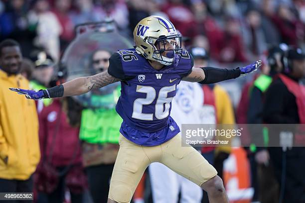 Defensive back Sidney Jones of the Washington Huskies celebrates an in incomplete pass during the first half of play against the Washington State...