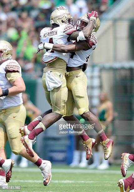 Defensive back Tarvarus McFadden of the Florida State Seminoles celebrates his interception against the South Florida Bulls during the 2nd quarter at...