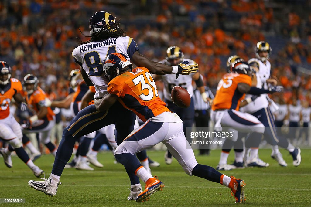defensive back Taurean Nixon #39 of the Denver Broncos breaks up a pass near the goal line intended for tight end Temarrick Hemingway #84 of the Los Angeles Rams during the fourth quarter at Sports Authority Field at Mile High on August 27, 2016 in Denver, Colorado. The Broncos defeated the Rams 17-9 in pre-season action.