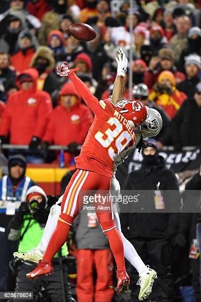 Defensive back Terrance Mitchell of the Kansas City Chiefs defends a pass in the end zone against wide receiver Seth Roberts of the Oakland Raiders...