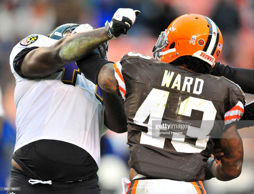 Defensive back <a gi-track='captionPersonalityLinkClicked' href=/galleries/search?phrase=T.J.+Ward&family=editorial&specificpeople=4640262 ng-click='$event.stopPropagation()'>T.J. Ward</a> #43 of the Cleveland Browns takes a swing at fullback <a gi-track='captionPersonalityLinkClicked' href=/galleries/search?phrase=Vonta+Leach&family=editorial&specificpeople=2147886 ng-click='$event.stopPropagation()'>Vonta Leach</a> #44 of the Baltimore Ravens during a game against the Baltimore Ravens at Cleveland Browns Stadium in Cleveland, Ohio. The Ravens won 25-15.
