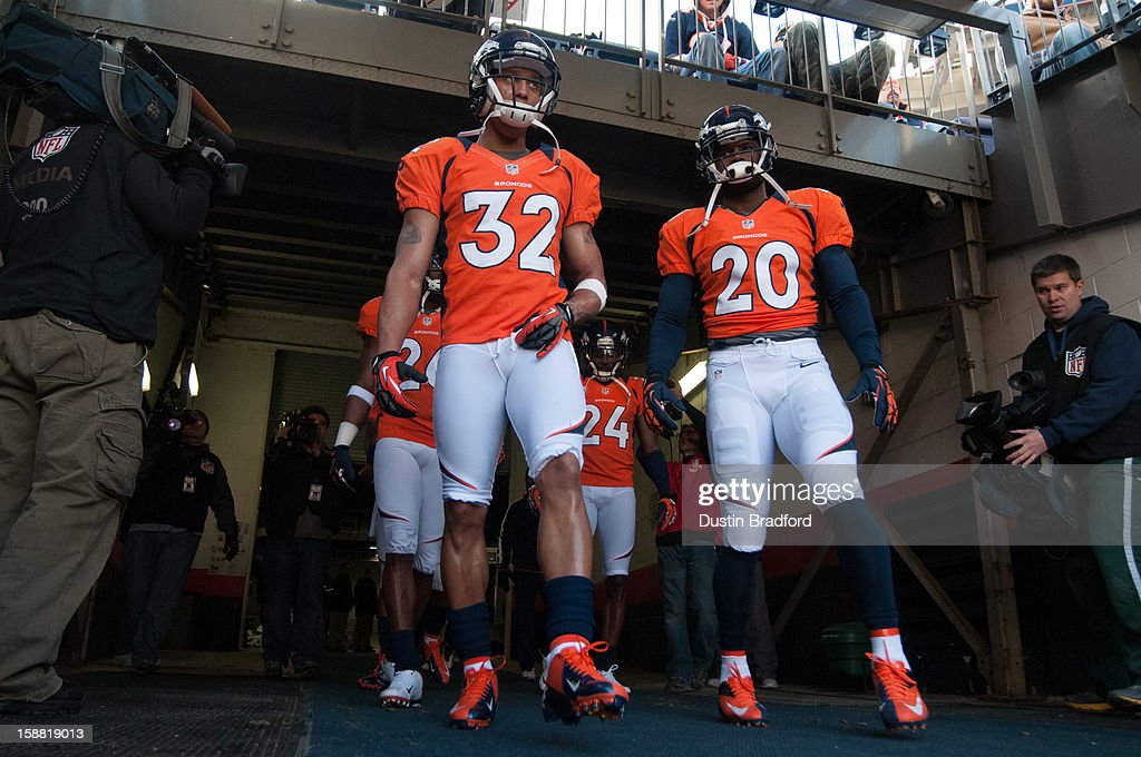 Defensive back Tony Carter #32 and strong safety Mike Adams #20, both of the Denver Broncos, emerge from the locker room for pre-game warmup before a game against the Kansas City Chiefs at Sports Authority Field Field at Mile High on December 30, 2012 in Denver, Colorado.