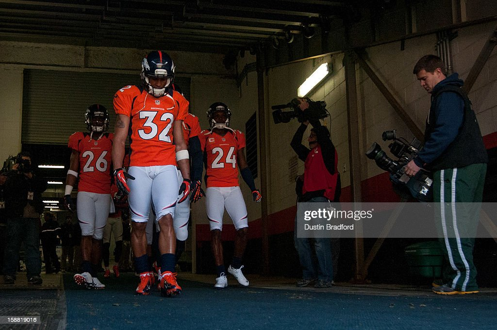 Defensive back Tony Carter #32, free safety Rahim Moore #26, and cornerback Champ Bailey #24, all of the Denver Broncos, emerge from the locker room for pre-game warmup before a game against the Kansas City Chiefs at Sports Authority Field Field at Mile High on December 30, 2012 in Denver, Colorado.