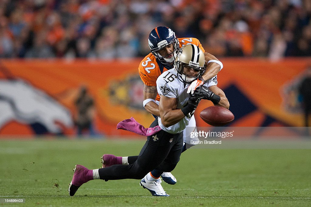 Defensive back Tony Carter #32 of the Denver Broncos breaks up a pass intended for wide receiver <a gi-track='captionPersonalityLinkClicked' href=/galleries/search?phrase=Lance+Moore&family=editorial&specificpeople=748984 ng-click='$event.stopPropagation()'>Lance Moore</a> #16 of the New Orleans Saints during a game at Sports Authority Field Field at Mile High on October 28, 2012 in Denver, Colorado.