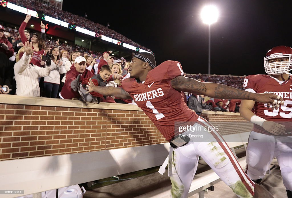 Defensive back Tony Jefferson #1 of the Oklahoma Sooners celebrates with fans after the game against the Oklahoma State Cowboys November 24, 2012 at Gaylord Family-Oklahoma Memorial Stadium in Norman, Oklahoma. Oklahoma defeated Oklahoma State 51-48 in overtime.